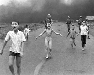 Girl running from napalm