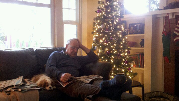Sully and me with the Sunday papers, Christmas 2011