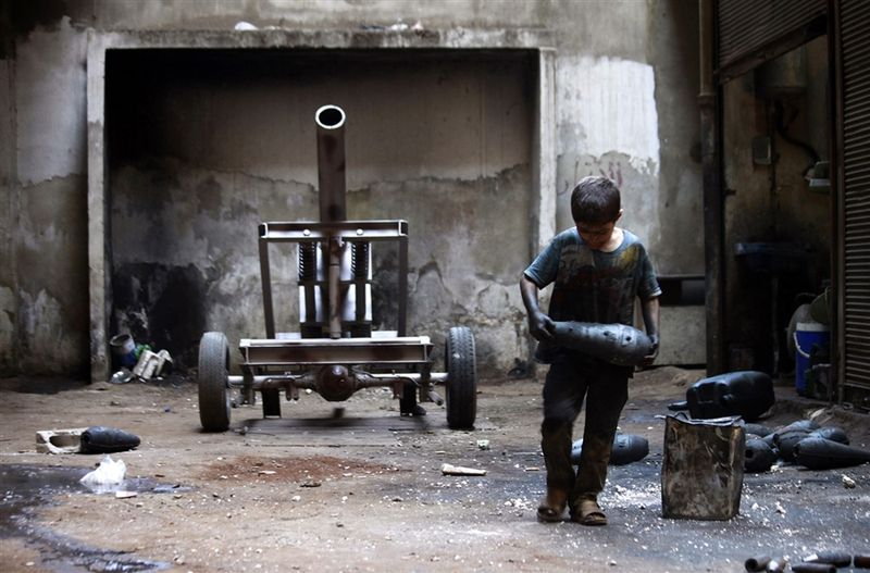 Syrian kid making artillery shells