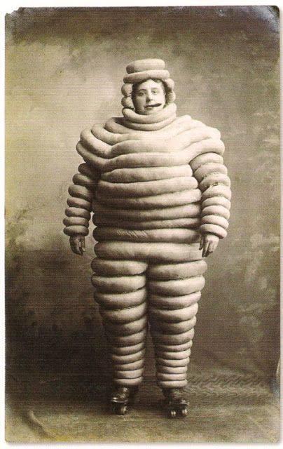 Michelin Man on roller skates smoking a cigar