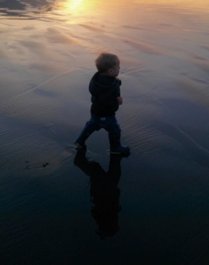 O at the beach at sunset
