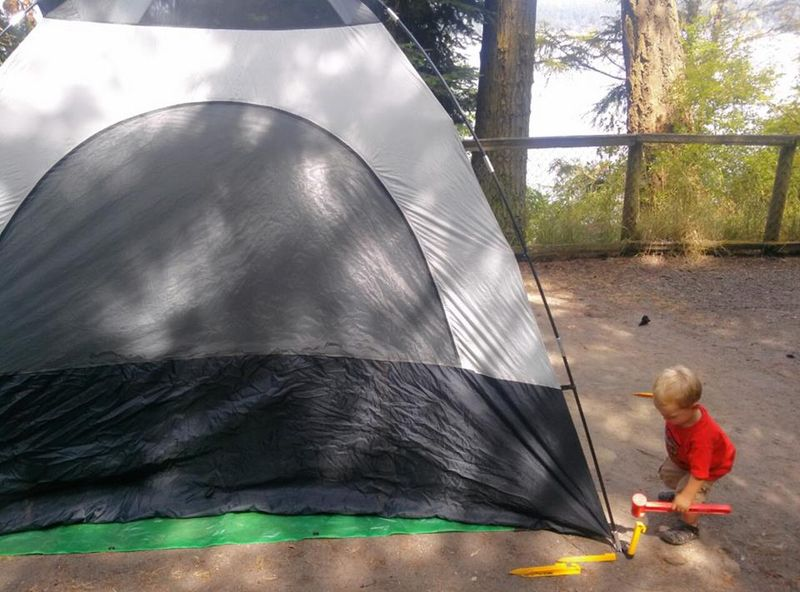 O helping put up the tent