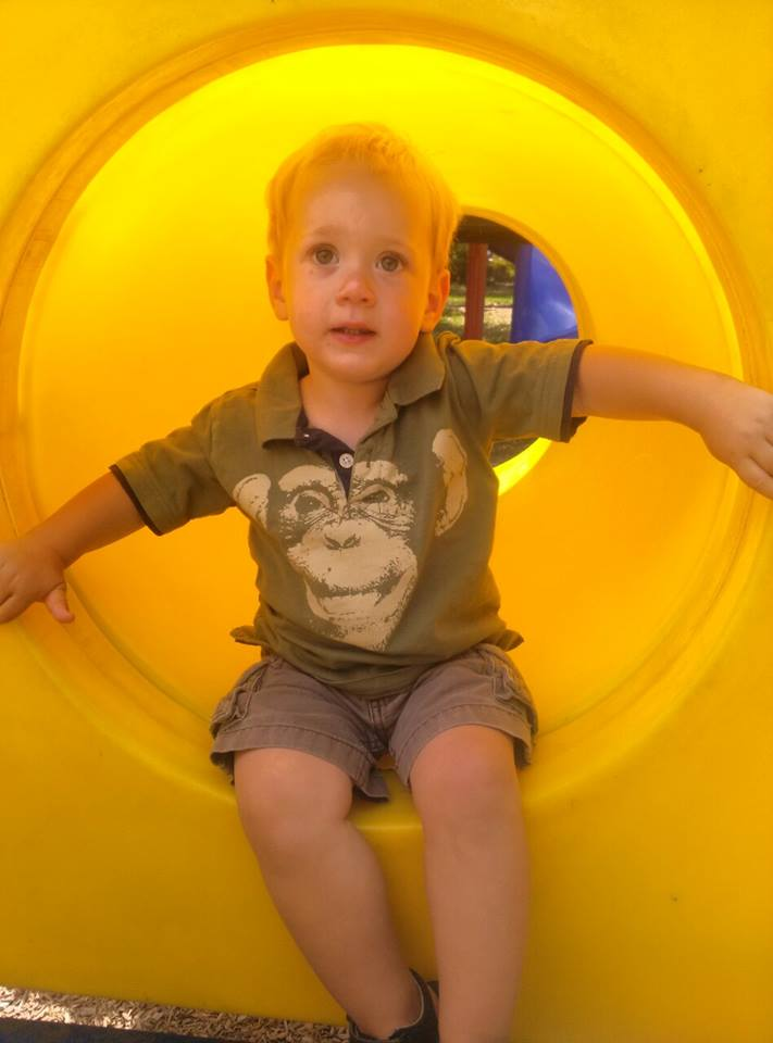 A boy and his big yellow tube thingie