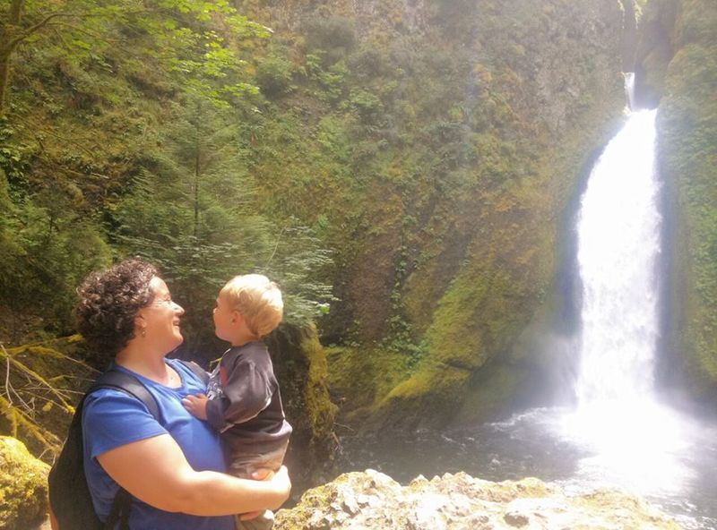 Boy, mommy and waterfall