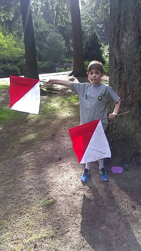 Friends' boy learning semaphore signals