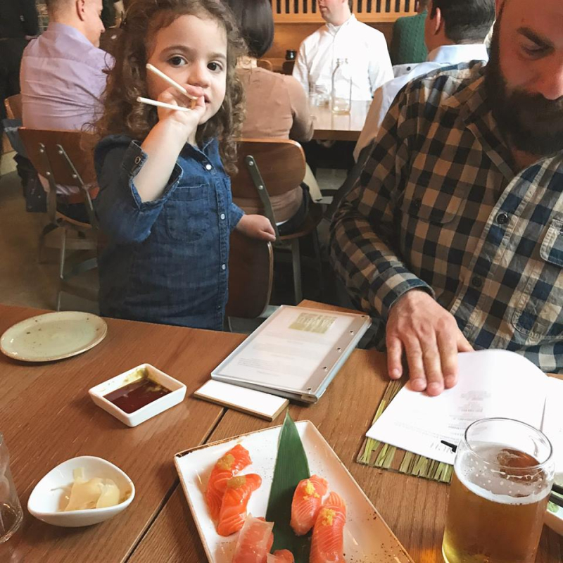 Eating sushi with her dad 1