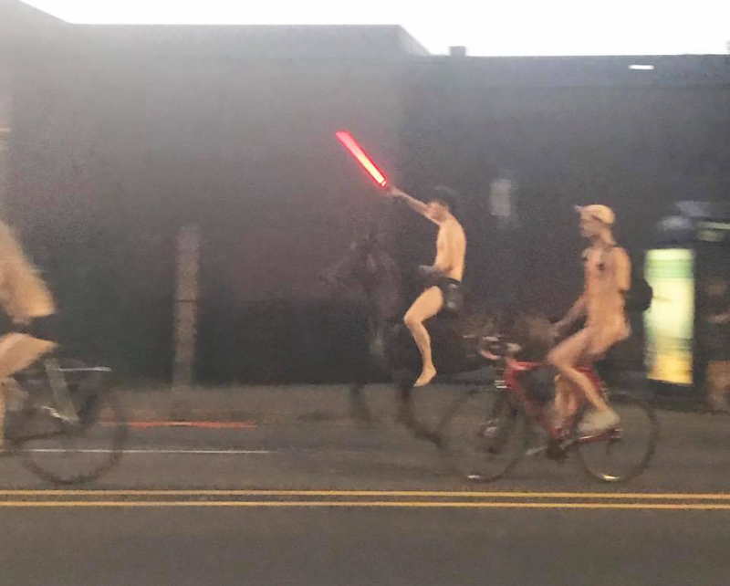 Naked man on black stallion with light saber
