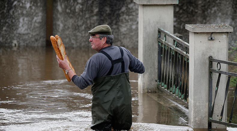 Frenchman in flood, with bread