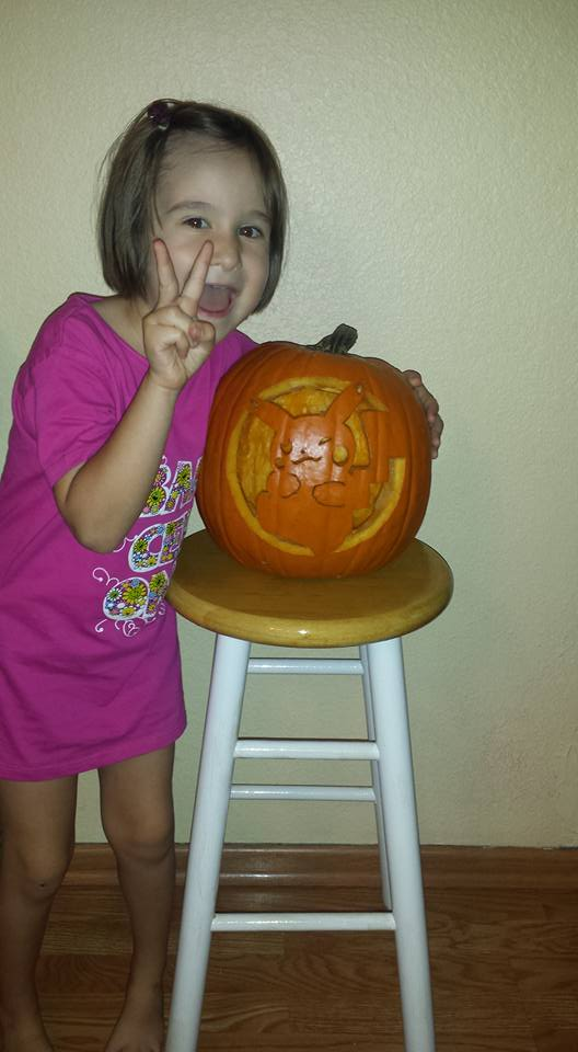 Bill's granddaughter with Pokemon pumpkin