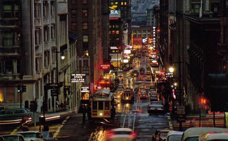 1958 - Powell Street at Bush Street on a rainy evening.