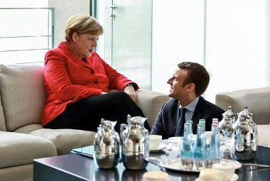 New President of France  at Merkel's feet