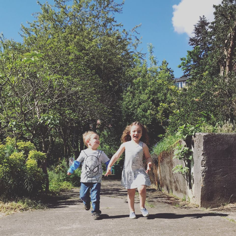 Olin and Ramona running down the street