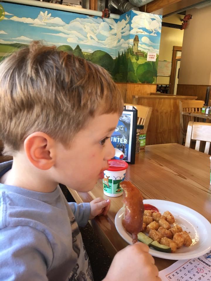 O eating corndog at Laurelwood Public House