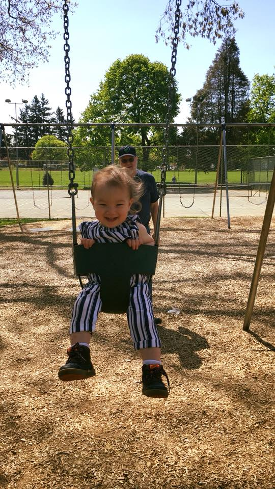 Pushing a little girl at the park