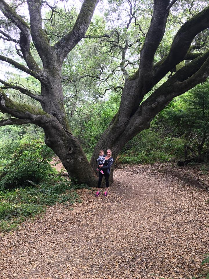 Robin and Kinsley by tree
