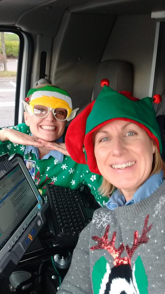 EMT elves dressed for Christmas