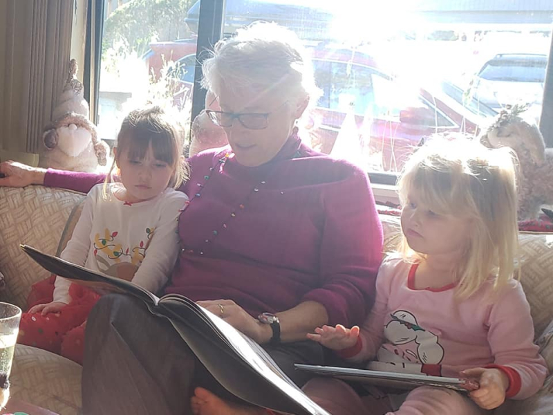 Aunt Amy reading a book to Bridget's kids