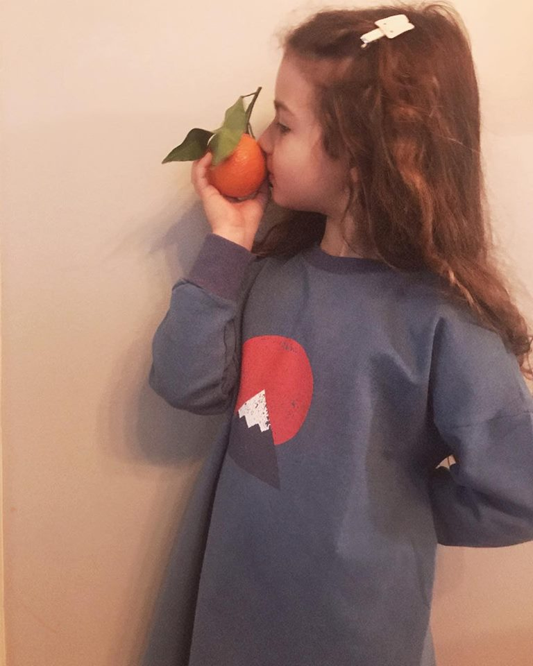 Girl and tangerine